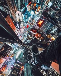 Daredevil Photographer Denis Krasnov Climbes Huge Skyscrapers To Take Stunning Photos