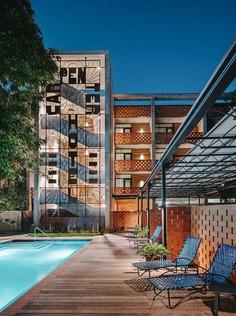 "mid-century-utilitarian"" carpenters' union hall building convert into hotel near downtown Austin"