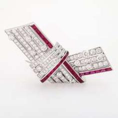 CARTIER loop brooch with precious stones