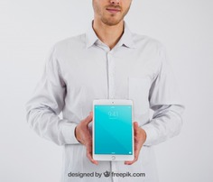 Smart businessman holding tablet Free Psd. See more inspiration related to Mockup, Business, People, Template, Light, Fashion, Man, Mobile, Presentation, 3d, Elegant, Business people, Corporate, Businessman, Mock up, Tablet, Company, Business man, Modern, Branding, App, Clean, Ipad, Psd, Mobile app, Display, Dark, Minimal, Professional, Smart, Application, Mockups, Up, Object, Holding, Realistic, Showcase, High resolution, Lcd, High, Mock, 3d mockup, Layered, Resolution, Minimalistic, Psd mockup and Realism on Freepik.