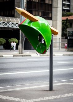 Pencil on green artphone booth #phone #public #booth #art #street #exterior #telephone