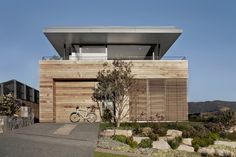 Modern Beach House Camouflaged as Driftwood Box: Lamble Residence