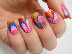 Ever wonder what would happen on your nails if you ever dipped them in rainbow? This is what you can get. Swirly, crazy and bold shapes of w