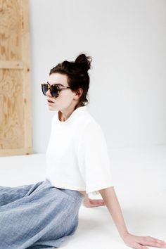 fashion, sunglasses, white blouse, grey trousers, bed, girl