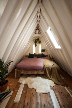 #attic #interior #roof #cozy #wood #bedroom