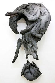 Wolf and rabbit sculpture (by Beth Cavener Stichter)