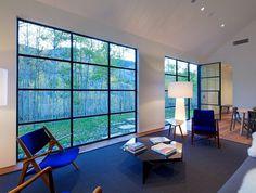 Cottage Black Provides a Retreat Within a Dense Aspen Grove 5