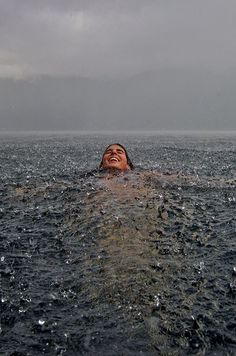infinite paradox:creditwhereitsdue:Swimming in the Rain Photo by Camila MassuAlways a reblog! #water #rain #swim #splash #fun