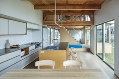 House in Field by Ship Architecture
