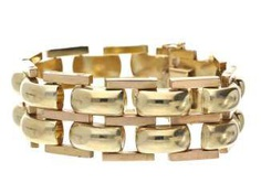 Bracelet: heavy and wide gold wrought band from the 50s