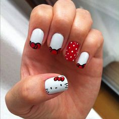 If you're looking for a simple French tip then this Hello Kitty design is perfect for you. The nails are tipped in white with an occasiona