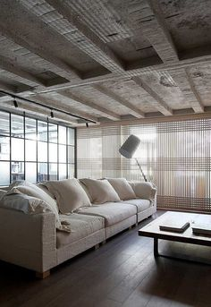 Kevin H. Chung #interior #sofa #concrete #bunker #living #home #wood #architecture #room