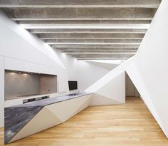 The Vortex House Has Folded Walls That Suggest Motion and Centrifugation 4