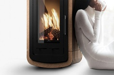 """Natura Cork Fireplace - IPPINKA If you ever need a portable fireplace, and one of quality, look no further than the Tek Lumber's Natura Cork Fireplace. The Natura is not only portable but it has an """"old school"""" feature of looking like a radiator, with the use of cork. The cork is modularly cut, and is movable if one chooses."""