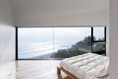 Two Storey House Situated at the Top of a Cliff