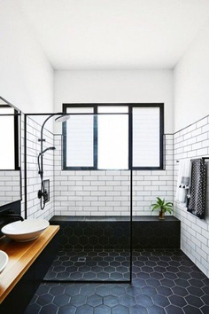 black hexagon tiles with white grout and white tiles with black grout look more eye-catching