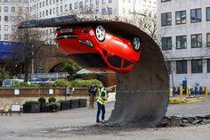 London Art Installation is an Upside Down Opel / Vauxhall Corsa Supermini #supermini #down #red #installation #london #art #corsa #open #vauxhall #upside