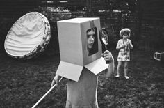 #photo #child #play #helmet #cardboard  Monika Strzelecka