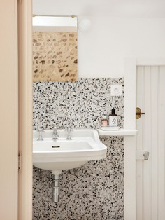 Italian terrazzo tiles from Palatino paired with an original sink and paneled door.