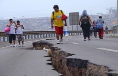 People walk along a cracked road in Iquique, northern Chile, on April 2, a day after a powerful 8.2-magnitude earthquake hit off Chile's Pa #inspration #photography #art