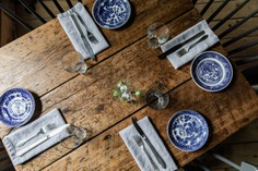 French sources the tableware from antiques stores around Maine; downstairs, in the pantry, there are stacks of blue-and-white china and jadeite bowls. French's mother, who works at the Lost Kitchen, sewed the restaurant's original cloth napkins.