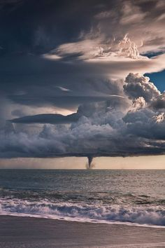 Water Spout, Liguria, Italy #ocean #clouds #tornado #spout #water #sea #photography #storm #beach #waves