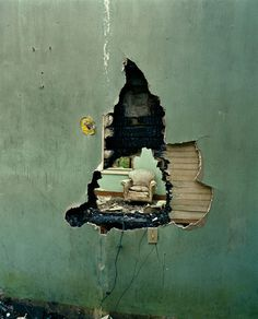 Mirrors and Windows: Photo #photo #wall #armchair #hole