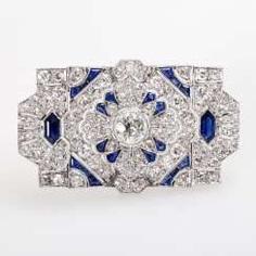 Brooch m. sapphires & many Diam.