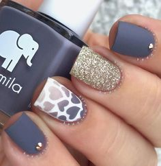 Matte blue gray nail polish with white and gold glitter. The matte design is accompanied by a gradient design as well in hear details. It lo