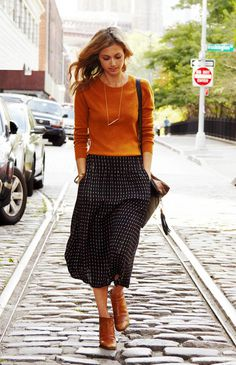 Burnt orange and black go well together for fall colors. Spice up your outfit with a necklace accessory killing the plain look of the top an