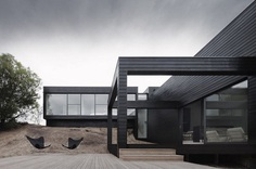 Contemporary Coastal Home with a Blackened Timber Facade
