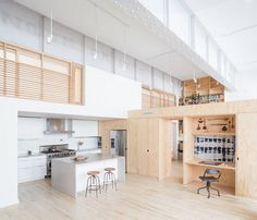 Old Carriage House Transformed into a Live-Work Studio by Jeff Jordan Architects