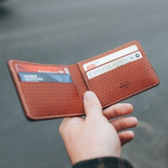 Minimalist Bi-Fold Wallet This Minimalist Bi-Fold Wallet is a classic wallet with ample room for unfolded bills. It has 6 interior pockets to fit all your cards in a downsized carry. Made with premium US leather. Laser cut and handcrafted in the US.