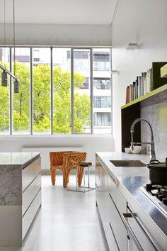 Dramatic Loft Apartment with Curvalicious White Interior