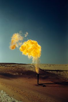 A pipe emits poisonous gases in a flame produced by oil production, April 1948.Photograph by Maynard Owen Williams, National Geographic
