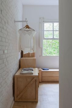Closet space with plywood boxes. Ap Cobogó by Alan Chu. #alanchu #minimalism #closet #box