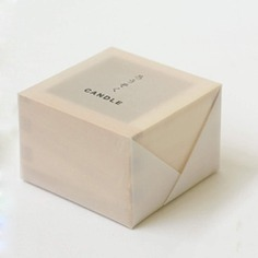 The Hinoki Masu Candle will add warmth to any living space. Made with hinoki-scented wax, it is housed in a flameproof sake cup (masu) holder which is also made of hinoki wood. Hinoki or Japanese cypress is prized for its wood grain and subtle but distinct scent. This woodsy and slightly citrusy aroma is deeply soothing and calming.