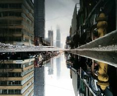 Reflections in The Puddles of Toronto by Guido Gutierrez Ruiz
