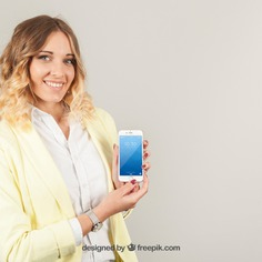 Good looking woman showing smartphone Free Psd. See more inspiration related to Mockup, Business, Technology, Template, Woman, Phone, Girl, Mobile, Smartphone, Mock up, Modern, App, Mobile phone, Display, Business woman, Good, Device, Up, Feminine, Looking, Mock and Showing on Freepik.