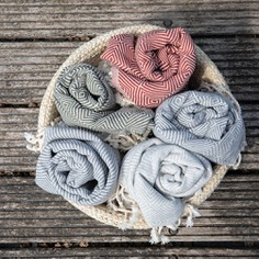 These Recycled Hammam Towels are traditional Turkish towels woven using unbleached cotton and reclaimed fabric waste. They are lightweight, super absorbent yet quick-drying and soft, making them excellent bath or beach towels. With a timeless herringbone pattern and knotted tassels, they also look beautiful as a throw blanket, picnic rug or an oversized scarf.