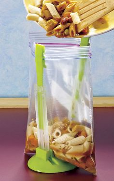 Mess-free way of transferring food into a zip lock bag.