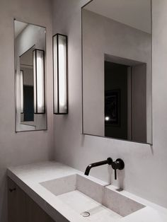 #Bathroomvanity with recessed #mirrorcabinet and #integratedsink. #ENApartment by #MarcMerckxInteriors. Photo by #DominiqueSmet.