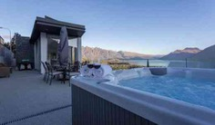 This lakefront home is perfect for couples or families.The light filled and spacious villa has a luxury alpine charm and fantastic views over to the lake and mountains. The outdoor dining space is perfect for entertaining outdoors or enjoying a Jacuzzi after a day of exploring Queenstown.