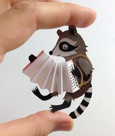 #paper #figure #raccoon #accordion #papercut
