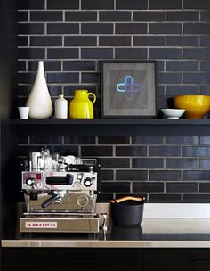 Kitchen with black brick wall #interiors #brick