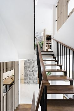 DANstudio Renovates House in Hanoi with Green Balconies Facade 6