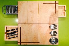 This all in one cutting board holds cups, a juicer, a grater, drawers and splits into two for convenience and easy cleaning! #productdesign