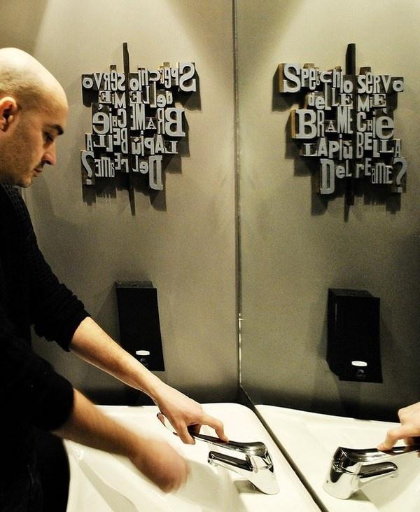 Toilet room with artistic wall decor #artistic #pizzeria #decor #restaurant #art #pizza #decoration