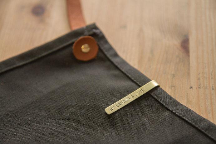 http://theworkbench.sg/v2/labour-love/ #apron #ryan #workbench #branding #design #graphic #the #craft #letter #tag #handmade #brass #len #name #fashion #punch #singapore