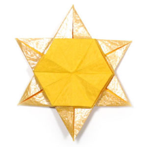 How to make a 2D six-pointed origami star (http://www.origami-make.org/howto-origami-star.php)